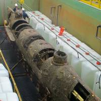 The Confederate submarine H.L. Hunley, which sank in 1864, sits in a conservation tank at a lab in North Charleston, South Carolina. | AP