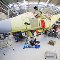 A Gripen fighter jet is seen at Saab's factory in Linkoping, Sweden, on May 5. Stockholm's foreign weapons clients include states criticized for human rights abuses, including Saudi Arabia, the United Arab Emirates and Pakistan. | AFP-JIJI