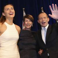 Tony Abbott, then in opposition, celebrates victory in Australia's national election on Sept. 7 in Sydney. | REUTERS