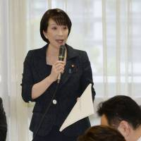 Sanae Takaichi, head of a Liberal Democratic Party task force on the economy, hosts a meeting in Tokyo on Tuesday. | KYODO