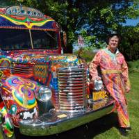 Zane Kesey poses with the latest version of the psychedelic bus Further in Pleasant Hill, Oregon, on May 14. | AP