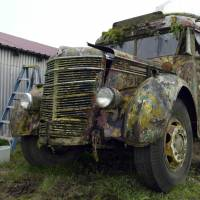 The 1939 bus that author Ken Kesey and the Merry Pranksters drove into psychedelic history is seen at the Kesey family farm in Pleasant Hill, Oregon, in December 2005. | AP