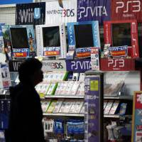 An electronics store displays video games for Nintendo Co.'s Wii, Wii U and 3DS machines and Sony Computer Entertainment Inc.'s PlayStation consoles in Osaka last week. | BLOOMBERG
