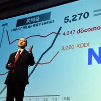 Masayoshi Son, CEO of communications giant SoftBank Corp., announces the firm's annual financial results in Tokyo on Wednesday. | AFP-JIJI