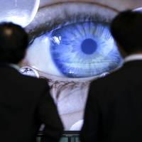 Visitors examine the detail in a Sony Corp. 4K Bravia LCD television screen at the company's headquarters in Tokyo last week. | BLOOMBERG