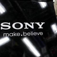 A Sony placard is displayed at an electronics store in Tokyo on Wednesday. | REUTERS