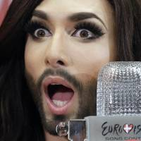 Austrian entertainer Conchita Wurst, who won last weekend's Eurovision Song Contest, speaks to journalists at Schwechat Airport, near Vienna, on Sunday. | AFP-JIJI