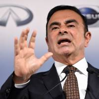 Nissan Chairman and CEO Carlos Ghosn announces the automaker's financial results for the year to March 31 in Yokohama on Monday. | AFP-JIJI