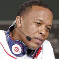 Recording artist Dr. Dre wears Beats headphones at the Major League baseball season opener between the New York Yankees and the Boston Red Sox at Boston's Fenway Park in April 2010. | REUTERS