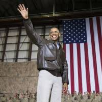 U.S. President Barack Obama arrives at a rally with troops during his unannounced visit to Bagram Air Base in Afghanistan on Sunday. | AP