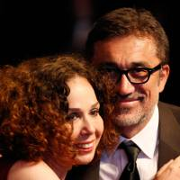 Turkish director Nuri Bilge Ceylan (right) celebrates with producer Zeynep Ozbatur Atakan after being awarded with the Palme d'Or for 'Winter Sleep' at the Cannes Film Festival in France on Saturday. | AFP-JIJI
