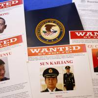 Press materials seen Monday at the Justice Department in Washington, ahead of Attorney General Eric Holder's news conference announcing that a U.S. grand jury had charged five Chinese military hackers with economic espionage and trade secret theft. | AP