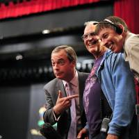 U.K. Independence Party leader Nigel Farage (left) prepares for an interview in the city of Southampton on Sunday, as his upstart Euroskeptic party swept polls in some parts of Britain. | AFP-JIJI