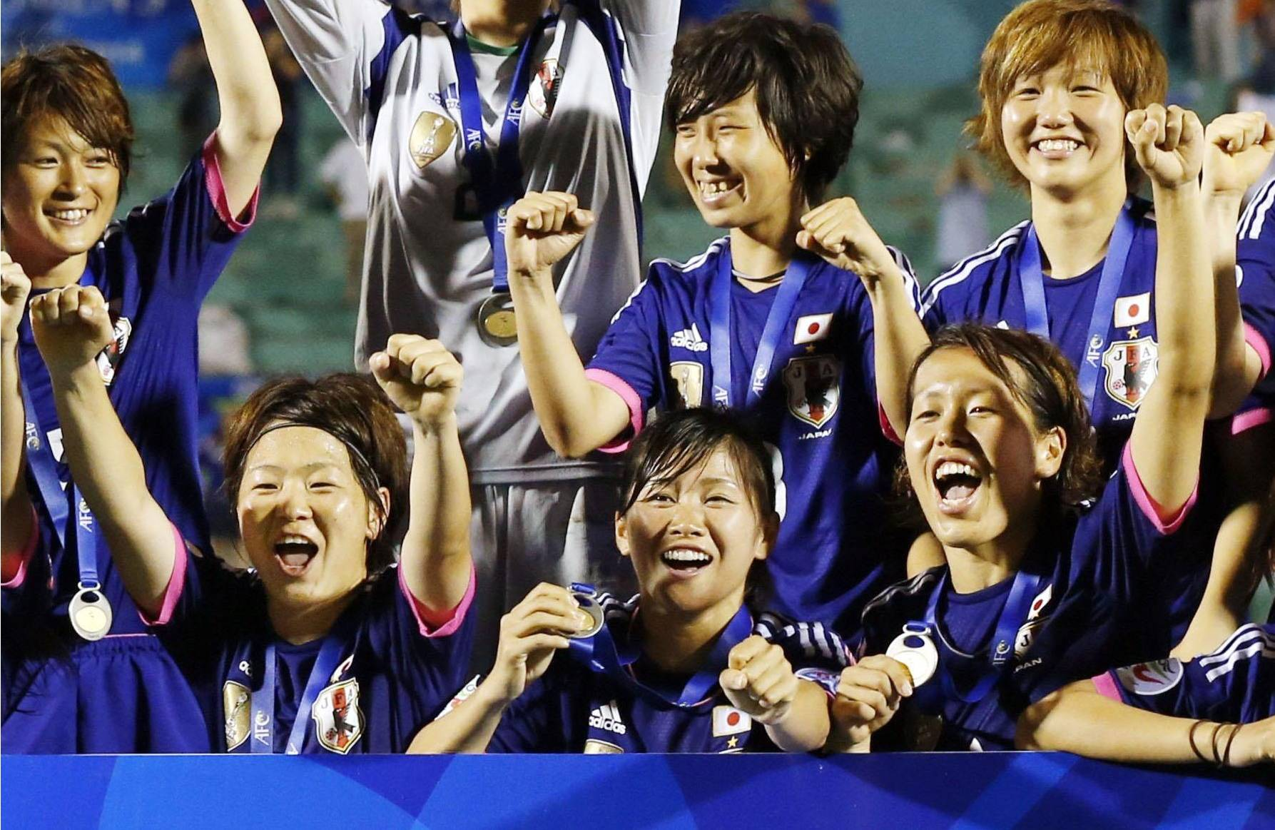 Thrill of victory: Members of Nadeshiko Japan celebrate after beating Australia 1-0 on Sunday to win their first Women's Asian Cup. | KYODO