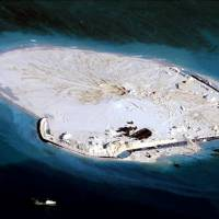 An alleged Chinese land reclamation project on what is internationally recognized as the Johnson Reef in the South China Sea is seen in this undated photo. The Philippines warned on Wednesday that China may be building an airstrip on the reef, boosting its claim to most of the strategic waters. | AFP-JIJI