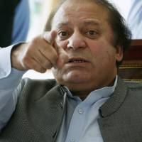 Pakistani Prime Minister Nawaz Sharif speaks to foreign reporters at his residence in Lahore in this file photo.   REUTERS
