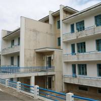 An apartment building is seen in a village outside Pyongyang where four surviving former Red Army Faction hijackers are believed to be living. The men hijacked a Japan Airlines airplane on an internal flight in 1970 and defected to North Korea. | KYODO