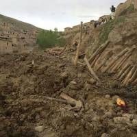 Afghan rescuers search for survivors after a massive landslide buried a village in Badakhshan province on Friday. | AP