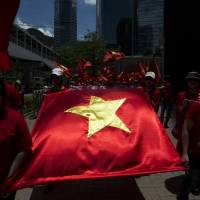 Around 200 Vietnamese residents of Hong Kong rally on Sunday against China's assertion of control over territory Vietnam also claims.   REUTERS