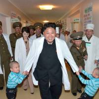 North Korean leader Kim Jong Un is seen on a recent tour of an orphanage, at Taesongsan General Hospital in Pyongyang. | AFP-JIJI