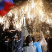 Fireworks explode over the bay in the Crimean port of Sevastopol during Victory Day celebrations on Friday. | REUTERS
