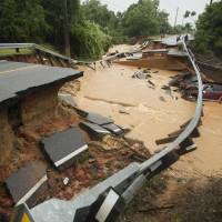 Damage from flash flooding is seen in Pensacola, Florida, on Wednesday. | REUTERS