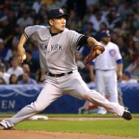 Start over: New York starter Masahiro Tanaka delivers a pitch during the first inning of the Yankees' 6-1 loss to the Cubs on Tuesday. | AP