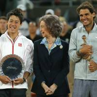 Say cheese: Madrid Open runnerup Kei Nishikori (left) and champion Rafael Nadal (right) pose with Spain's Queen Sofia after the tournament on Sunday. | AP