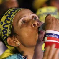 An anti-government protester blows a whistle during a rally in Bangkok on Wednesday.   AP