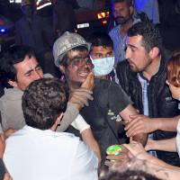 A rescued miner surrounded by relatives, medics and other miners in Soma, western Turkey, on May 13, 2014. An underground explosion and fire left dozens of miners dead and hundreds trapped, early reports said, citing officials. | REUTERS