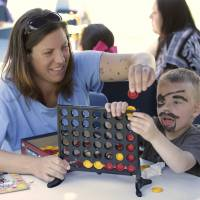 An inmate plays a game with her son, Noah, during his visit to the Folsom Women's Facility in Folsom, California, on May 3. The name Noah sailed past Jacob to become the most popular U.S. baby name for boys in 2013, ending Jacob's 14-year run at the top.   AP
