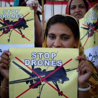 Pakistanis protest against U.S. drone strikes in tribal areas in Peshawar on April 23, 2011. | AP