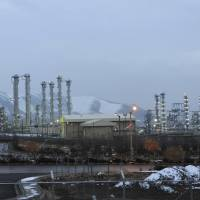 Iran's heavy water nuclear facility is backdropped by mountains near the central city of Arak, Iran. International nuclear inspectors will visit two sites in Iran in the coming days, the country's official news agency reported Sunday, a move that would fulfill a series of demands made by the United Nations nuclear watchdog. | AP