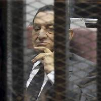Egypt's ousted President Hosni Mubarak sits in the dock at the police academy on the outskirts of Cairo on Wednesday. | REUTERS