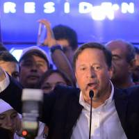 Juan Carlos Varela celebrates after winning the presidential election in Panama City on Sunday. | AFP-JIJI