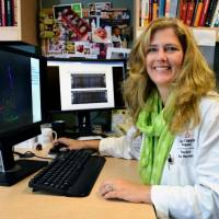 This photo provided by the Baylor College of Medicine shows Dr. Kjersti Aagaard working in her laboratory at Baylor in Houston on Tuesday. Research she led shows that bacteria live in the placentas of pregnant women, and hints that the microbes may play a role in premature births. | AP