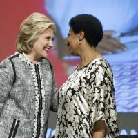Former Secretary of State Hillary Rodham Clinton (left), talks with Phumzile Mlambo-Ngcuka, executive director, U.N. Women, as World Bank President Jim Yong Kim looks on, at the conclusion of the World Bank Group's report 'Voice and Agency: Empowering Women and Girls for Shared Prosperity' at the World Bank headquarters in Washington on Wednesday. | AP