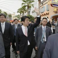 Prime Minister Shinzo Abe tours a casino resort in Singapore on Friday. | KYODO