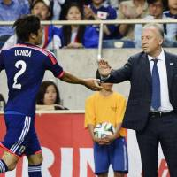 Pleasing result: Japan manager Alberto Zaccheroni congratulates Atsuto Uchida for scoring in the 43rd minute against Cyprus. | KYODO