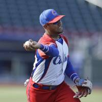 New addition: Third baseman Yulieski Gourriel, seen practicing before a Cuban exhibition game in July 2013, has played in three World Baseball Classics. Now he's anxious to make an impact for the Yokohama BayStars. | AP/KYODO