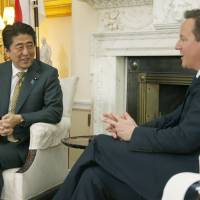 British Prime Minister David Cameron talks with his Japanese counterpart Shinzo Abe at his official residence, 10 Downing Street, in London Thursday. | KYODO