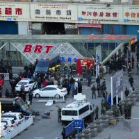 China blames Urumqi blast on suicide bombers; Xi demands action