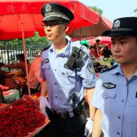 China offers leniency to suspects after Xinjiang bombing