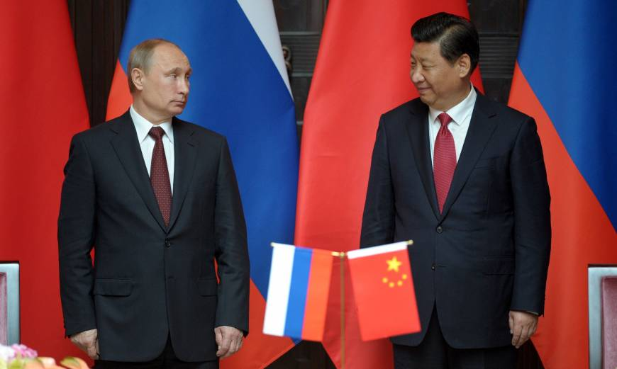 China, Russia pledge to build ties as Putin visits