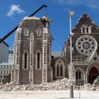 A crane lifts workers up to inspect the damaged Christchurch Cathedral on Feb. 24, 2011, two days after a deadly earthquake rocked New Zealand's second-largest city. | AFP-JIJI
