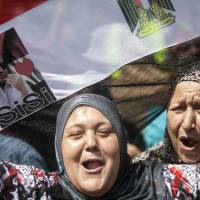 As Egypt votes, some still caught in political crossfire
