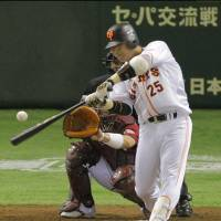 Textbook swing: The Giants' Shuichi Murata hits a solo home run in the second inning on Thursday. | KYODO