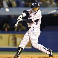 This one is gone: The Swallows' Yuhei Takai belts a fifth-inning home run against the Tigers on Monday at Jingu Stadium. Tokyo Yakult defeated Hanshin 13-1. | KYODO