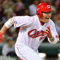 Man for the big occasion: Hiroshima's Ryuhei Matsuyama rounds the bases after hitting a tiebreaking RBI single in the seventh inning of the Carp's 3-2 win over the Dragons on Friday.   KYODO