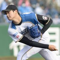 Dominating form: Fighters right-hander Shohei Otani fans nine batters in a 126-pitch outing at Ocean Stadium on Tuesday. Hokkaido Nippon Ham defeated the Seibu Lions 3-0. | KYODO
